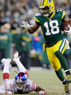 Green Bay Packers wide receiver Randall Cobb (18) runs after a catch for a touchdown past New York Giants cornerback Trevin Wade (31) in the third quarter as the Packers host the Giants in an NFC Wildcard game at Lambeau Field on Sunday, January 8, 2017, in Green Bay, Wis. The Packers defeated the Giants, 38-13.