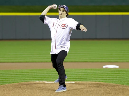 Nick Goepper throws out a ceremonial first pitch before