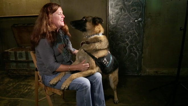 Marine Corps veteran Jessica McVay and her service dog, Radar, of the 'Telling: Tampa Bay' cast.