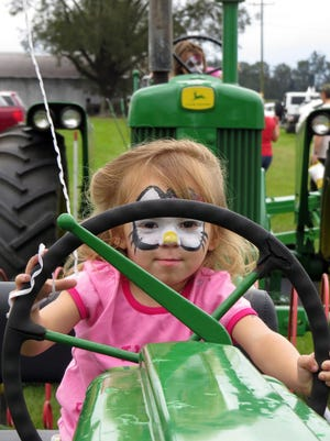 Alena Thomas takes the tractor wheel during a previous Jay Peanut Festival.