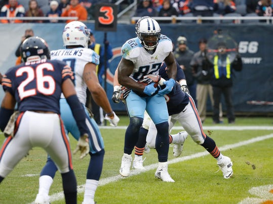 Tennessee Titans tight end Delanie Walker (82) runs to the end zone for touchdown against Chicago Bears inside linebacker Danny Trevathan (59) during the first half of an NFL football game, Sunday, Nov. 27, 2016, in Chicago. (AP Photo/Charles Rex Arbogast)