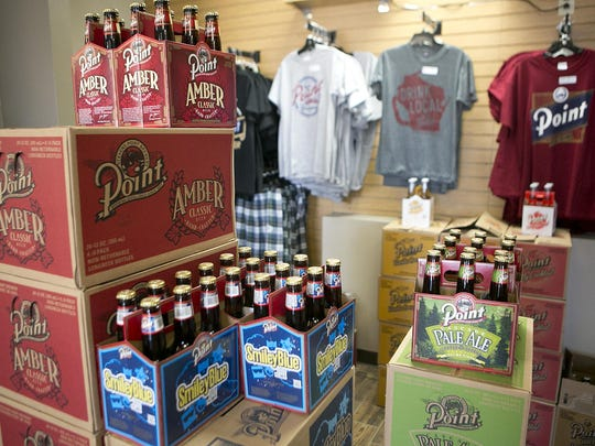 T-shirts and Point Brewery beer are on display at the remodeled gift shop at Point Brewery, Thursday, June 25, 2015.at Point Brewery, Thursday, June 25, 2015.