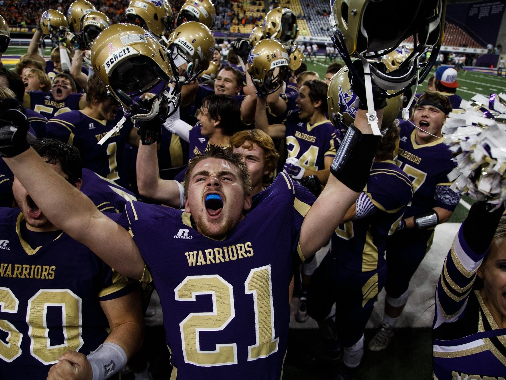Norwalk's Zachary Cook celebrates with his team after Thursday's semifinal win over Sergeant Bluff-Luton at the UNI-Dome.