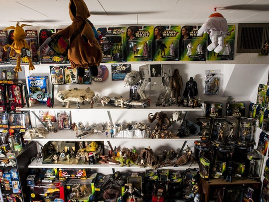 """Star Wars"" figurines are arranged on Pat Douglas' shelves in a room set aside for his collection."
