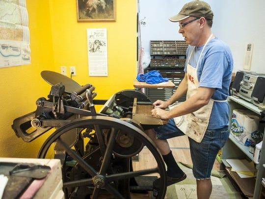Aaron Parrett runs his 1929 letterpress with a foot