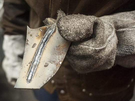 Tiffanie Carter shows her arc weld in her C.M. Russell