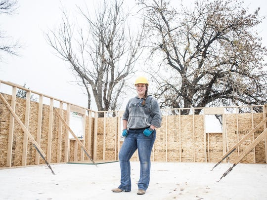 Tiffanie Carter stands in the C.M. Russell High School House that she is helping build for a class Monday.