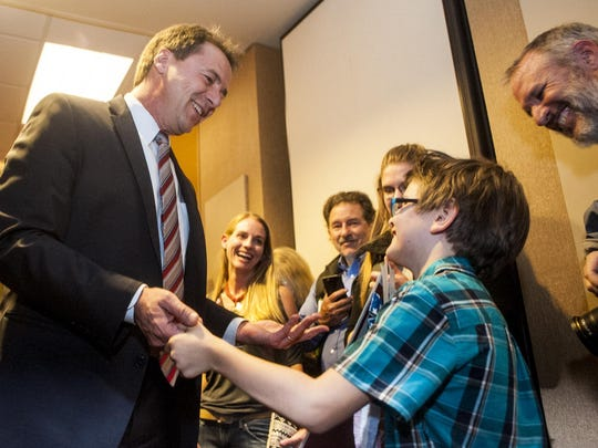 Gov. Steve Bullock greets Gabriel Granby, 8, who studied the elections in school, during the Democratic election night party Tuesday in Helena.
