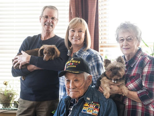 Andrew Kim, a military veteran and survivor of the Pearl Harbor attack, with his son-in-law, Ed Reed, his daughter, Debbie Reed, his wife Dolores Kim, who was also at Pearl Harbor in 1941, and their dogs Oscar and Susee.