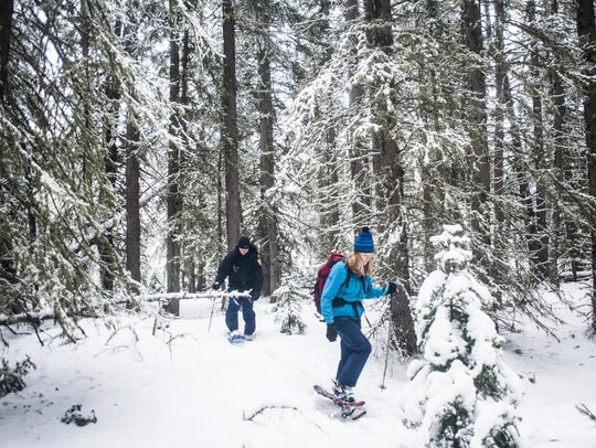 Wendy Cole and Daniel Madel snowshoe through Helena-Lewis