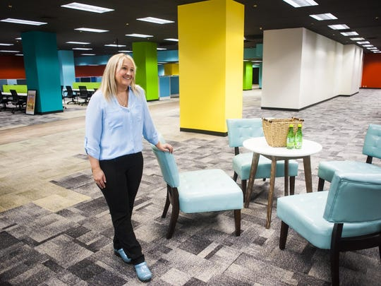 FCR human resources manager Holli Lanes leans on a chair during a tour of the colorful new call center at 410 Central Ave. The new business in downtown Great Falls contributed to GDP growth in the city in 2018.