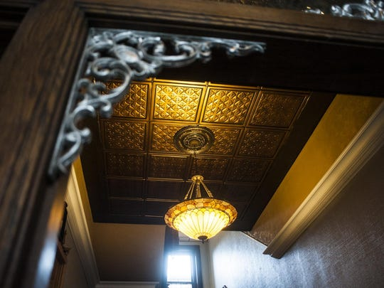 Developer Jason Madill restored the Pennant Building at 104 4th St. N. and uncovered tin ceilings, molding and stained glass light fixtures.