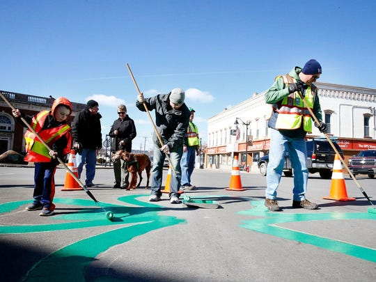 The painting of the shamrock in downtown Horseheads has become an annual tradition before the St. Patrick's Day parade.