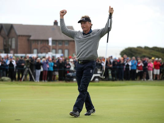 Germany's Bernhard Langer celebrates winning the Senior Open at Royal Porthcawl Golf Club, Porthcawl, Wales, Sunday, July 30, 2017. (Nick Potts/PA via AP)