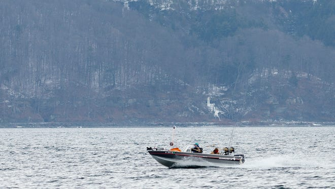 A boater skims across Cayuga Lake Saturday March 21, 2015.
