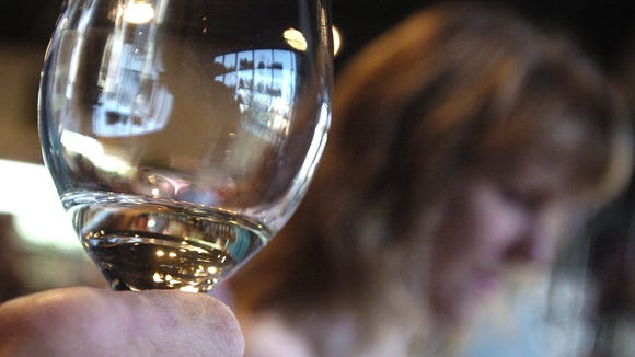 A white wine is swirled at a recent wine tasting at Wine Country in Shreveport.
