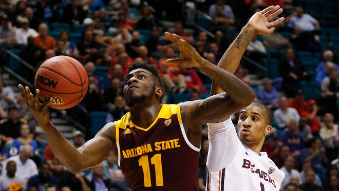 Arizona State forward Savon Goodman, left, shoots around Oregon State guard Gary Payton II during the first half of an NCAA college basketball game in the first round of the Pac-12 men's tournament Wednesday, March 9, 2016, in Las Vegas.