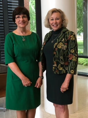 Michigan State University Trustees Dianne Byrum, left and Melanie Foster are heading the school's search for a permanent president.