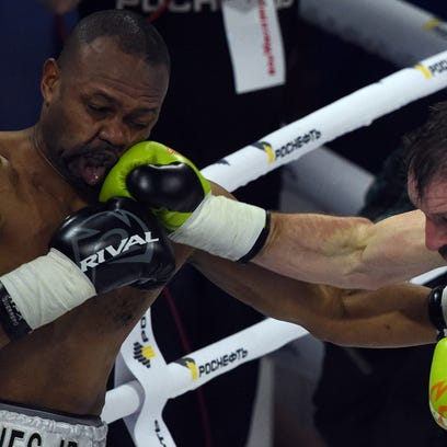 Roy Jones Jr. (left) exchanges punches with Enzo Maccarinelli