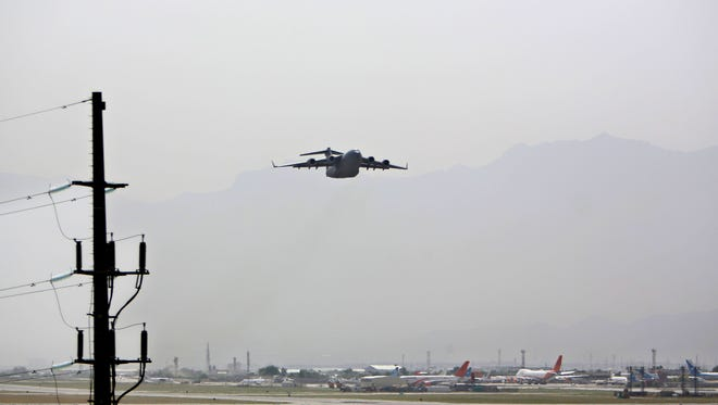 In this Tuesday, May 5, 2015 photo, an aircraft takes off at the Hamid Karzai International Airport in Kabul, Afghanistan.