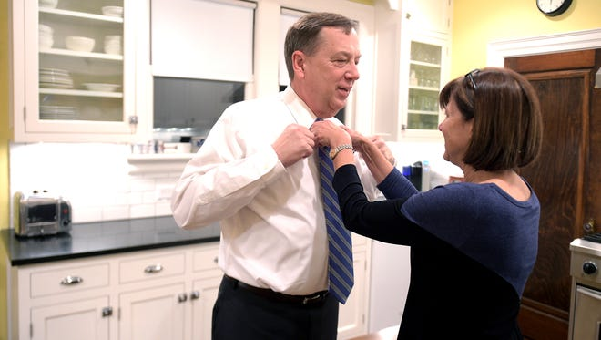 State Rep. Sam Whitson gets his tie adjusted by his wife, Pam, before leaving his Franklin home for Capitol Hill, where he is serving his first term as a lawmaker.