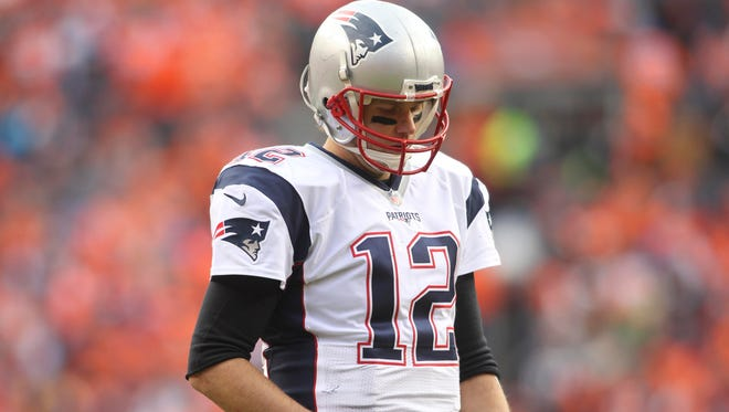 New England Patriots quarterback Tom Brady (12) during the second half in the AFC Championship football game at Sports Authority Field at Mile High.