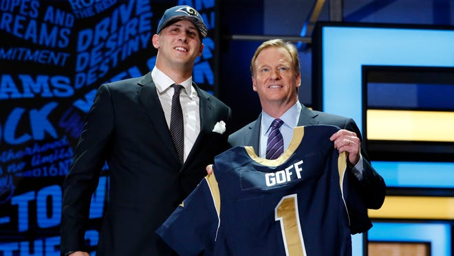 California' QB Jared Goff poses for photos with NFL commissioner Roger Goodell after being selected by the Los Angeles Rams as the first pick in the first round of the 2016 NFL football draft, Thursday in Chicago.