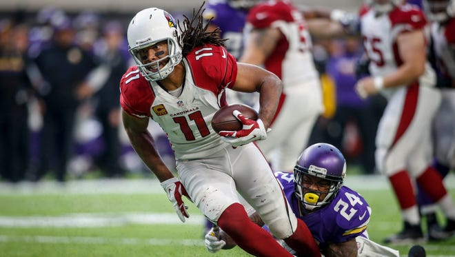 Nov 20, 2016; Minneapolis, MN, USA; Cardinals wide receiver Larry Fitzgerald (11) catches a pass as Vikings cornerback Captain Munnerlyn (24) tackles him in the fourth quarter at U.S. Bank Stadium. The Vikings win 30-24.