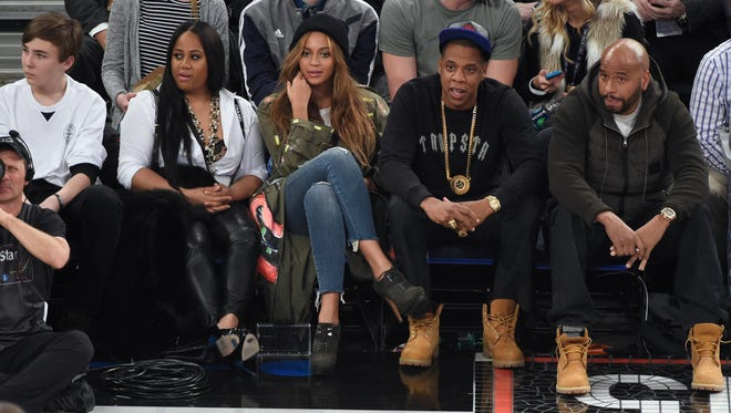NEW YORK, NY - FEBRUARY 15:  Beyonce and Jay Z attend The 64th NBA All-Star Game 2015 on February 15, 2015 in New York City.  (Photo by Kevin Mazur/WireImage) ORG XMIT: 531542707 ORIG FILE ID: 463539640