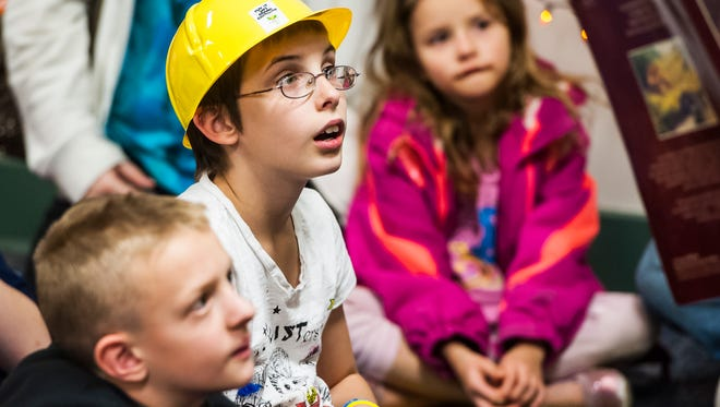 Lauren Seadorf, 10, intently listens to a teacher read Heckedy Peg as part of a celebration for Roosevelt Elementary winning the summer Readers' Challenge competition Tuesday, Oct. 27, 2015. Each student who participated was entered in a raffle for gift cards from Barnes and Noble.