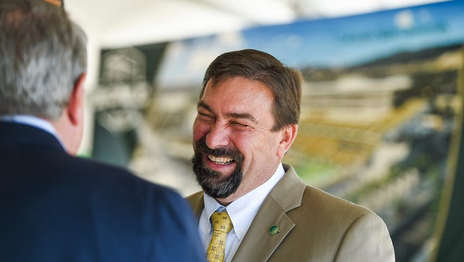 Colorado State University President Tony Frank talks with people before the stadium groundbreaking ceremony Saturday, Sept. 12, 2015, in Fort Collins.