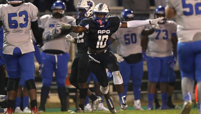 Godby's Cortez Andrews celebrates a stop on third down against Trinity Christian Academy during their Region 1-5A Semifinal game at Cox Stadium on Friday, Nov. 17, 2017.