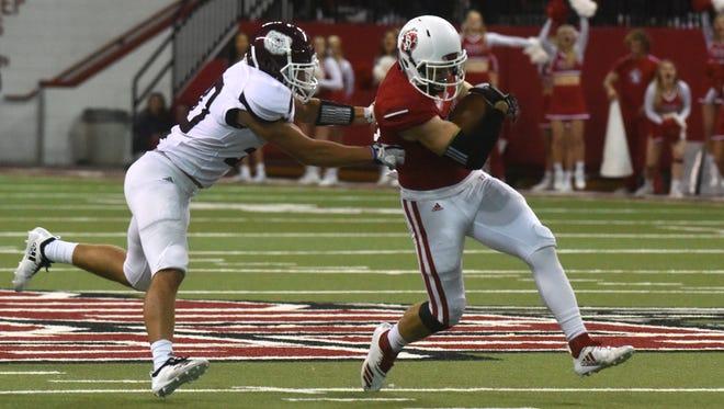 University of South Dakota's Brett Samson (81) runs the ball during a game against Missouri State, Saturday, Oct. 6, 2018 in Vermillion, S.D.
