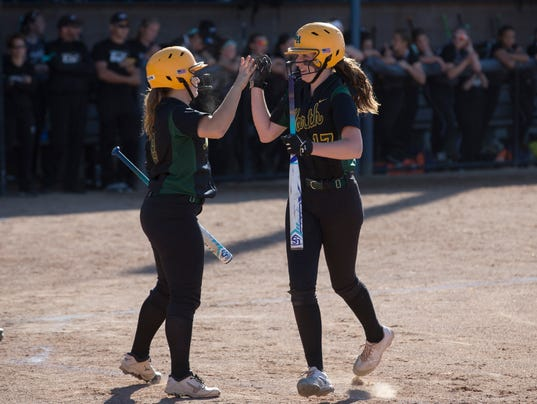 636321233516741816-Meghan-Graham-right-gets-a-high-five-from-teammate-Maggie-Swan-after-scoring-a-run-during-the-first-inning-at-Saturday-s-Group-IV-final.jpg