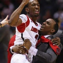 Andre McGee hoists Russ Smith in the air after Louisville beat Duke on the way to its 2013 NCAA national championship