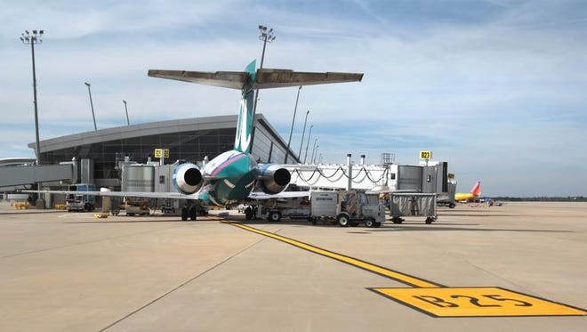 An AirTran jet is shown at the Indianapolis International Airport terminal on Tuesday, Sept. 17, 2013.