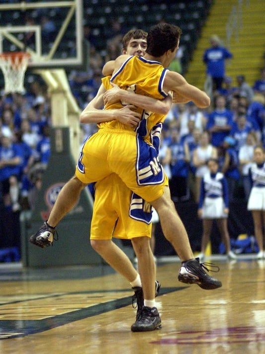 2003.0315.13.ditphoto-MoellervsHam-2-Moeller H.S 3 Rob Christie jumps into the arms of 4 Bubba Walther after Walters hit a three point shot to end the 3rd Period as time ran out in the period. As Moeller was beating up on Hamilton H.S in the Division l Cha