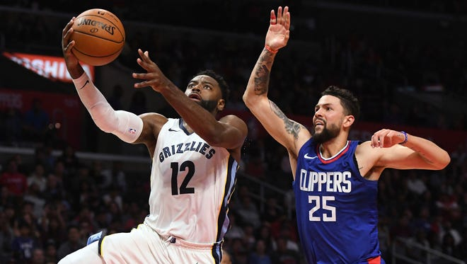 Memphis Grizzlies guard Tyreke Evans (12) beats Los Angeles Clippers guard Austin Rivers (25) off the dribble for a layup during the second half of an NBA basketball game, Saturday, Nov. 4, 2017, in Los Angeles. (AP Photo/Michael Owen Baker)
