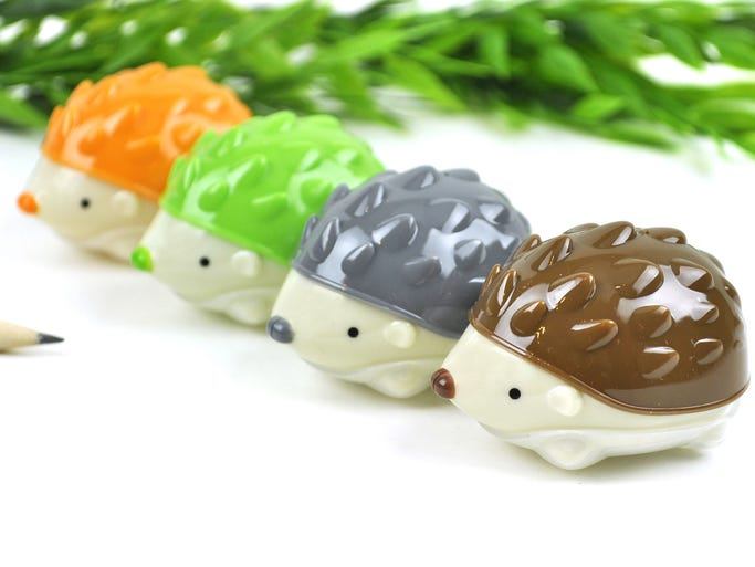 This product image released by Coolpencilcase.com shows Hedgehog Pencil Sharpeners.The average family with kids in kindergarten through 12th grade will spend $669.28 on apparel, shoes, supplies and electronics, up five percent from last year, according to the trade group?s 2014 Back-to-School Survey.
