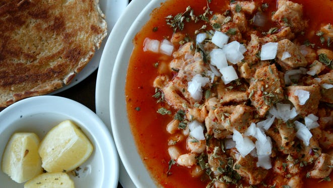 Menudo, bread and lemon, from Good Luck Cafe, 3813 Alameda.