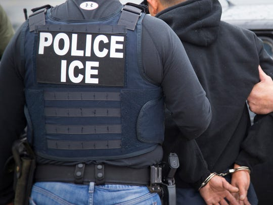 U.S. Immigration and Customs Enforcement agents make