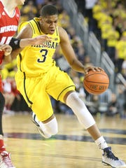 Michigan swingman Kameron Chatman drives against Wisconsin