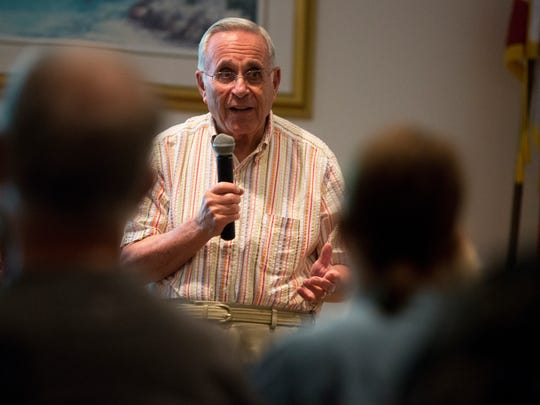 Steen Metz, a Holocaust survivor and advocate for the The Holocaust Museum & Education Center of Southwest Florida, speaks to a group of 80-plus guests at the Naples Regional Library on Thursday, Jan. 26, 2017, in Naples. Metz, originally from Denmark, spoke of his time in Jewish concentration camps as an 8-year-old boy, the struggles he and his family faced, and the lessons he learned.
