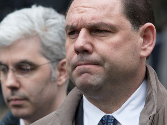 Joseph Percoco, right, a former top aide to New York Gov. Andrew Cuomo, reacts while talking to reporters outside U.S. District court, Tuesday, March 13, 2018, in New York. Percoco was convicted on corruption charges Tuesday at a trial that further exposed the state capital's culture of backroom deal-making.