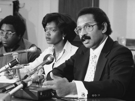Rep. John Conyers talks to reporters during a press conference in Washington in 1977. Conyers called the briefing to announce a national day of protest in the Alan Bakke case. The case, formally Regents of the University of California v. Bakke, ruling in which, on June 28, 1978, the U.S. Supreme Court declared affirmative action constitutional but invalidated the use of racial quotas.