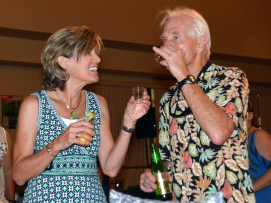 Salley Sorensen and Michael Davis sample one of the many tequilas available at the Tequila, Taco & Cerveza event, previously held at the New Mexico Farm & Ranch Heritage Museum. This year, the festival will take place at the Plaza de Las Cruces.