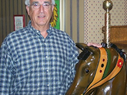Mark Taddonio is a York Township orthodontist who does wooden carvings, including carousel horses.