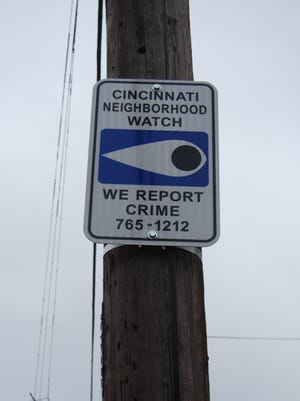 Placement of Neighborhood Watch signs along Grand Avenue in Price Hill is among several recent efforts initiated by the Grand Neighbors Neighborhood Watch. Jan. 23, 2018