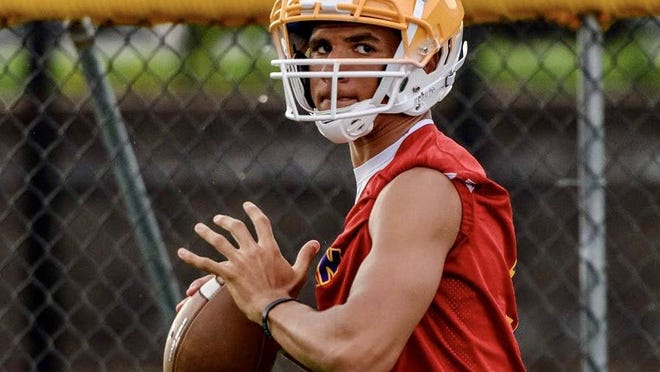 Hickman's TJ Turner prepares to throw the ball during preseason practice Tuesday at Hickman High School.