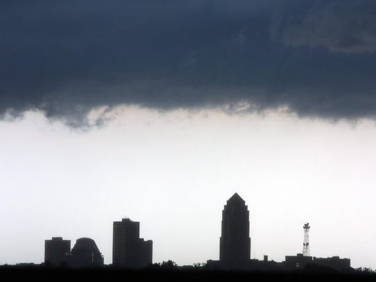 Severe thunderstorm clouds roll over the Des Moines skyline as a storm front arrives in the metro in 2009.